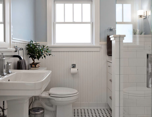 A 1980s renovation had stripped the charm from this circa 1910 Craftsman home's bathroom, leaving it dark, dated and cramped.